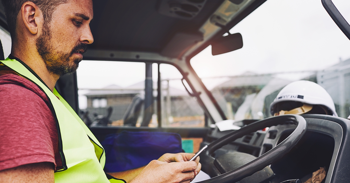 Trucker using phone in cab
