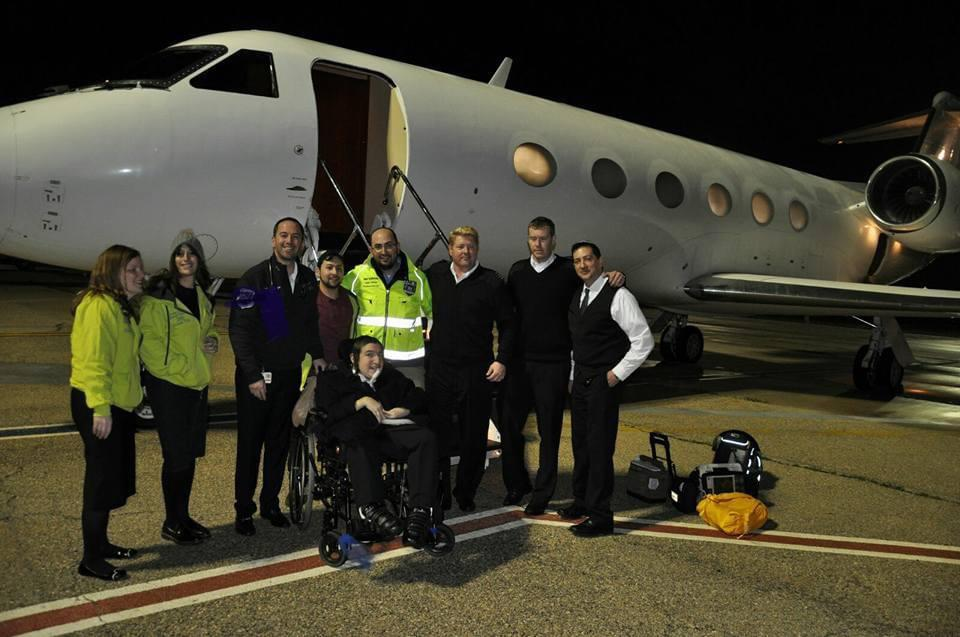 Students with disability preparing to board plane